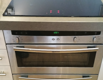 An integrated hob and oven